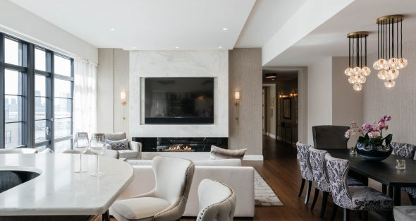 Living room with fireplace in marble casing