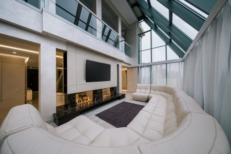 TV over a marble fireplace