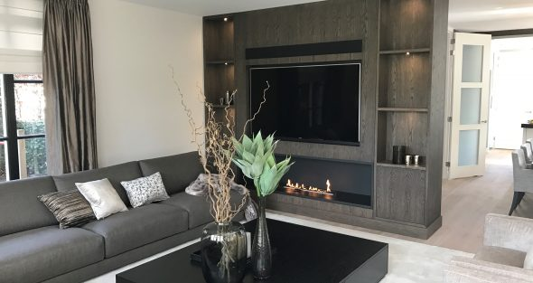 fireplace and TV in wooden housing